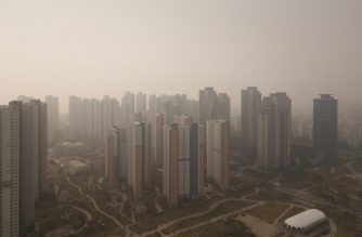 FILES: This aerial photo taken on November 6, 2018 shows a general view of high-rise apartment buildings during heavy pollution in Songdo, west of Seoul. (Photo by Ed JONES / AFP)