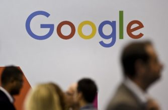 (FILES) In this file photo taken on November 8, 2017, people pass by the Google logo at the Web Summit in Lisbon. - Seven European consumer groups filed complaints against Google with national regulators on November 27, 2018 for covertly tracking users' movements in violation of a EU regulation on data protection. (Photo by PATRICIA DE MELO MOREIRA / AFP)