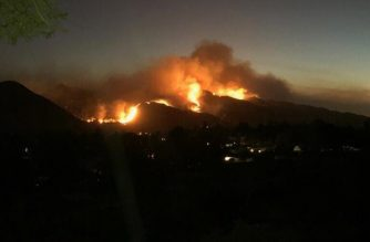 Flames and smoke from Southern California wildfires are seen from Simi Valley. Photo by Chelzie Mangona/ EBC Los Angeles Bureau/Eagle News/