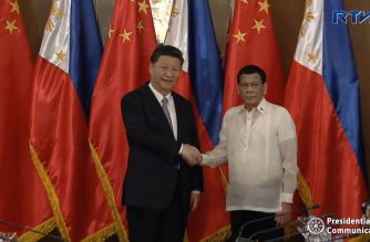 China's President Xi Jinping and Philippine president Rodrigo Duterte pose for an official photo during the first day of the Chinese leader's two-day state visit in the country.  (Photo grabbed from RTVM video)