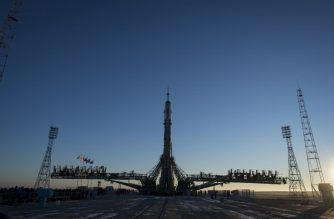 """In this photo released by NASA, the Soyuz booster rocket and MS-11 spacecraft siton the launch pad after being rolled out by train on December 1, 2018, at the Baikonur Cosmodrome in Kazakhstan. - The launch of the Soyuz MS-11 spacecraft with members of the International Space Station (ISS) expedition 58/59, Russian cosmonaut Oleg Kononenko, NASA astronaut Anne McClain and David Saint-Jacques of the Canadian Space Agency is scheduled on December 3, 2018 from the Russian-leased Kazakh Baikonur cosmodrome. (Photo by Aubrey GEMIGNANI / NASA / AFP) / RESTRICTED TO EDITORIAL USE - MANDATORY CREDIT """"AFP PHOTO / NASA/Aubrey Gemignani"""" - NO MARKETING NO ADVERTISING CAMPAIGNS - DISTRIBUTED AS A SERVICE TO CLIENTS"""