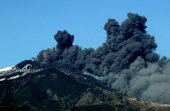 (File photo) Smoke rises near the city of Catania during an eruption of the Mount Etna, one of the most active volcanoes in the world on December 24, 2018. (Photo by GIOVANNI ISOLINO / AFP)