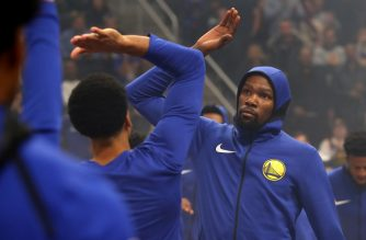 DETROIT, MICHIGAN - DECEMBER 01: Kevin Durant #35 of the Golden State Warriors is introduced prior to playing the Detroit Pistons at Little Caesars Arena on December 01, 2018 in Detroit, Michigan. NOTE TO USER: User expressly acknowledges and agrees that, by downloading and or using this photograph, User is consenting to the terms and conditions of the Getty Images License Agreement.   Gregory Shamus/Getty Images/AFP