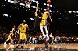 NEW YORK, NEW YORK - DECEMBER 18: Jarrett Allen #31 of the Brooklyn Nets blocks the shot of LeBron James #23 of the Los Angeles Lakers during their game at the Barclays Center on December 18, 2018 in New York City.   Al Bello/Getty Images/AFP