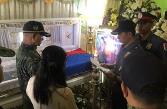 Philippine National Police Chief Oscar Albayalde is seen visiting the wake of Rep. Rodel Batocabe in Albay./Office of the Chief PNP/