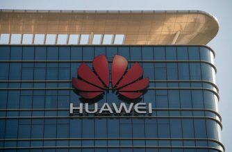 The Huawei logo is seen on a Huawei office building in Dongguan in China's southern Guangdong province on December 18, 2018. (Photo by Nicolas ASFOURI / AFP)