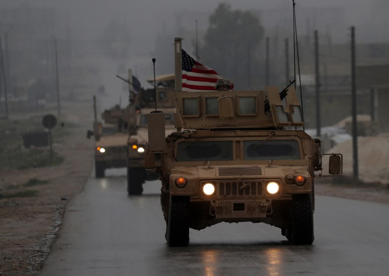 Trump appears to slow Syria troop pullout plan