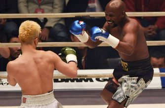 "US boxing legend Floyd Mayweather Jr (R) smiles during an exhibition match against Japanese kickboxer Tenshin Nasukawa at the Saitama Super Arena in Saitama on December 31, 2018. - Floyd Mayweather won against Japanese kickboxing phenomenon Tenshin Nasukawa by a technical knock-out in the first round of a New Year's Eve ""exhibition"" bout that brought the US boxing superstar out of retirement. (Photo by Toshifumi KITAMURA / AFP)"