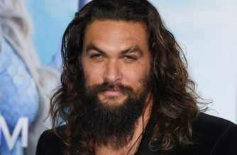 "(FILES) In this file photo taken on December 12, 2018 US actor Jason Momoa arrives for the world premiere of ""Aquaman"" at the TCL Chinese theatre in Hollywood. - ""Aquaman"" left other movies in its wake in North American box offices this weekend, taking in an estimated $30.7 million, industry watcher Exhibitor Relations said January 6, 2019. The DC super-hero film, in its third week out, has now taken in a global total of $940.7 million. That makes it Warner Bros.' biggest comic-book film since ""The Dark Knight Rises"" earned more than $1 billion in 2012, according to Variety.com. (Photo by Mark RALSTON / AFP)"