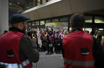 Security staff attend a four-hour strike at Berlin's Tegel airport on January 7, 2019. - Hundreds of German passengers were facing travel upheaval with security staff at Berlin's two airports walking out in a pay dispute. The action was called by the powerful Verdi union that wants to see wages raised to 20 euros ($23) per hour for workers carrying out passenger, freight, personnel and goods checks at German airports. (Photo by Tobias SCHWARZ / AFP)