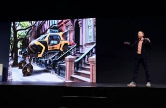 """David Byron, industrial design manager for Sundberg-Ferar, speaks about the Hyundai Elevate, an """"Ultimate Mobility"""" concept vehicle, during the Hyundai press conference at the Mandalay Bay Convention Center during CES 2019 in Las Vegas, Nevada on January 7, 2019. - The """"walking car"""" is envisioned with articulating legs to traverse any terrain making it ideal for mobility for disabled persons as well as for emergency response in natural or manmade disasters. (Photo by Robyn Beck / AFP)"""
