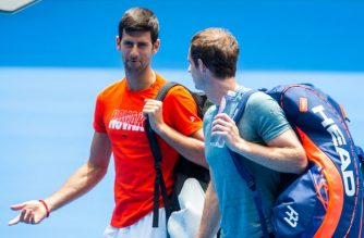 Serbia's Novak Djokovic (L) and Britain's Andy Murray arrive on court during a practice session in Melbourne on January 10, 2019, ahead of the Australian Open tennis tournament. (Photo by ASANKA BRENDON RATNAYAKE / AFP) / -- IMAGE RESTRICTED TO EDITORIAL USE - STRICTLY NO COMMERCIAL USE --