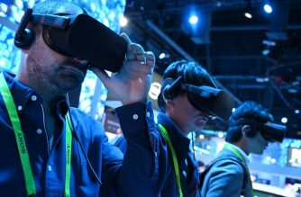 Attendees take a virtual reality tour at the Intel booth at CES 2019 consumer electronics show, January 10, 2019 at the Las Vegas Convention Center in Las Vegas, Nevada. (Photo by Robyn Beck / AFP)