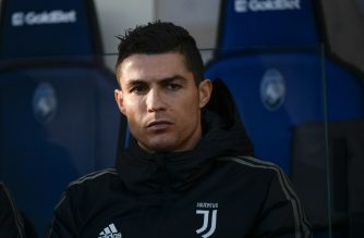 """(FILES) In this file photo taken on December 26, 2018 Juventus' Portuguese forward Cristiano Ronaldo looks on from the substitutes' bench prior to the Italian Serie A football Match Atalanta Bergamo vs Juventus at the Atleti Azzurri d'Italia stadium in Bergamo. - Las Vegas police have asked soccer star Cristiano Ronaldo to submit a DNA sample as part of their investigation into accusations of rape made against the Juventas forward. Ronaldo's lawyer, Peter Christiansen, played down the significance of the warrant issued, telling AFP in a statement on January 10, 2019 that it was standard procedure in a probe. """"Mr Ronaldo has always maintained, as he does today, that what occurred in Las Vegas in 2009 was consensual in nature, so it is not surprising that DNA would be present, nor that the police would make this very standard request as part of their investigation,"""" the statement said. (Photo by Marco BERTORELLO / AFP)"""