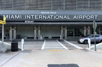 This image shows the outside area of the Miami International airport on January 11, 2018 one day before it closes its Terminal G. - The international airport in Miami has been forced to shut down one of its terminals early for three days due to a shortage of security agents sparked by the partial US government shutdown now in its 21st day. From Saturday through Monday, Terminal G -- one of six at the airport -- will close at 1:00 pm (1800 GMT). (Photo by Gianrigo MARLETTA / AFP)