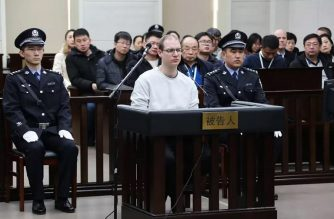"""This photograph taken and released by the Intermediate Peoples' Court of Dalian on January 14, 2019 shows Canadian Robert Lloyd Schellenberg (C) during his retrial on drug trafficking charges in the court in Dalian in China's northeast Liaoning province. - The court sentenced Schellenberg to death on drug trafficking charges on January 14, 2019 after his previous 15-year prison sentence was deemed too lenient, a ruling that has deepened a diplomatic rift between Ottawa and Beijing. (Photo by HANDOUT / HO / AFP) / -----EDITORS NOTE --- RESTRICTED TO EDITORIAL USE - MANDATORY CREDIT """"AFP PHOTO / Intermediate Peoples' Court of Dalian"""" - NO MARKETING - NO ADVERTISING CAMPAIGNS - DISTRIBUTED AS A SERVICE TO CLIENTS - NO ARCHIVES"""