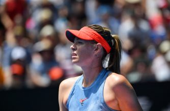 Russia's Maria Sharapova reacts after a point against Australia's Ashleigh Barty during their women's singles match on day seven of the Australian Open tennis tournament in Melbourne on January 20, 2019. (Photo by SAEED KHAN / AFP) / -- IMAGE RESTRICTED TO EDITORIAL USE - STRICTLY NO COMMERCIAL USE --