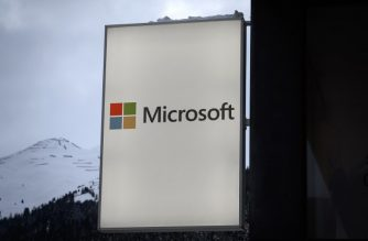 A picture taken on January 21, 2019 shows a sign of Microsoft, ahead of the World Economic Forum (WEF) 2019 annual meeting in Davos, eastern Switzerland. (Photo by Fabrice COFFRINI / AFP)
