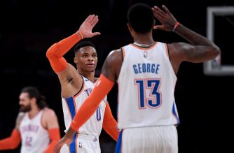 LOS ANGELES, CALIFORNIA - JANUARY 02: Russell Westbrook #0 and Paul George #13 of the Oklahoma City Thunder celebrate a dunk during the first half against the Los Angeles Lakers at Staples Center on January 02, 2019 in Los Angeles, California. NOTE TO USER: User expressly acknowledges and agrees that, by downloading and or using this photograph, User is consenting to the terms and conditions of the Getty Images License Agreement.   Harry How/Getty Images/AFP