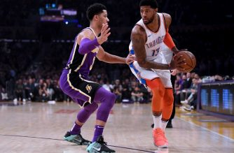 LOS ANGELES, CALIFORNIA - JANUARY 02: Paul George #13 of the Oklahoma City Thunder is guarded by Josh Hart #3 of the Los Angeles Lakers during a 107-100 Thunder win at Staples Center on January 02, 2019 in Los Angeles, California. NOTE TO USER: User expressly acknowledges and agrees that, by downloading and or using this photograph, User is consenting to the terms and conditions of the Getty Images License Agreement.   Harry How/Getty Images/AFP
