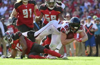 Logan Paulsen #82 of the Atlanta Falcons dives for a first down after a 19-yard reception from Matt Ryan #2 during the fourth quarter against the Tampa Bay Buccaneers at Raymond James Stadium on December 30, 2018 in Tampa, Florida. The Falcons won 34-32.   Julio Aguilar/Getty Images/AFP