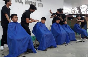 Free haircut is given to students at the New Era Elementary School in Quezon City during the EBC Cares program, of media network Eagle Broadcasting Corporation, on Friday, January 25, 2019.   (Eagle News Service)