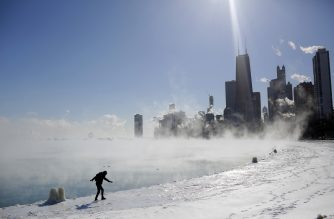 Marius Radoi keeps his balance as he walks on the edge of Lake Michigan's shore line as temperatures dropped to -20 degrees F (-29C) on January 30, 2019 in Chicago, Illinois. - Frostbite warnings were issued for parts of the US Midwest on January 30, 2019, as temperatures colder than Antarctica grounded flights, forced schools and businesses to close and disrupted life for tens of millions. (Photo by JOSHUA LOTT / AFP)