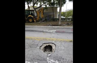 "This handout photograph obtained courtesy of the FBI shows the opening of a 50-yard tunnel leading to a Chase Bank branch January 30, 2019 in Pembroke Pines, Florida. - Road workers in Florida sent out to repair a sinkhole got a surprise this week when they discovered it was caused by a tunnel leading to a nearby bank. The FBI posted pictures of the narrow underground tunnel leading to a branch of Chase Bank in Pembroke Pines, about 20 miles (32 kilometers) north of Miami. Police and the FBI were called in Tuesday night, January 30, 2019 after the road workers realized that a manhole-sized hole in the road was caused by a tunnel. Further digging revealed a crude 50-yard (46-meter) tunnel leading from a wooded area to the bank on S Flamingo Road. The tunnel was just wide enough for a single person to crawl through on their stomach. The FBI said in a tweet that it was treating the case as an ""attempted bank burglary."" (Photo by HO / FBI / AFP) / == RESTRICTED TO EDITORIAL USE  / MANDATORY CREDIT:  ""AFP PHOTO /  FBI MIAMI"" / NO MARKETING / NO ADVERTISING CAMPAIGNS /  DISTRIBUTED AS A SERVICE TO CLIENTS  == / ""The erroneous mention[s] appearing in the metadata of this photo by FBI MIAMI has been modified in AFP systems in the following manner: [FBI as a Source] instead of [AFP as a Source]. Please immediately remove the erroneous mention[s] from all your online services and delete it (them) from your servers. If you have been authorized by AFP to distribute it (them) to third parties, please ensure that the same actions are carried out by them. Failure to promptly comply with these instructions will entail liability on your part for any continued or post notification usage. Therefore we thank you very much for all your attention and prompt action. We are sorry for the inconvenience this notification may cause and remain at your disposal for any further information you may require."""
