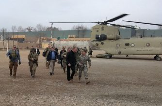 Acting Pentagon chief Patrick Shanahan (front 2nd R) arrives in Kabul on February 11, 2019. - Acting Pentagon chief Patrick Shanahan arrived in Afghanistan on a surprise visit on February 11 as the United States seeks to support the Kabul government while negotiating peace with the Taliban. (Photo by Sylvie LANTEAUME / AFP)