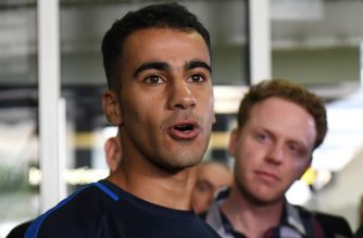 Footballer Hakeem al-Araibi (L) speaks to the media upon his arrival at the airport in Melbourne on February 12, 2019. - Refugee footballer Hakeem al-Araibi made a triumphant return to Australia on February 12, ending a two month ordeal that saw him jailed in Thailand and threatened with forced return to his native Bahrain. (Photo by WILLIAM WEST / AFP)