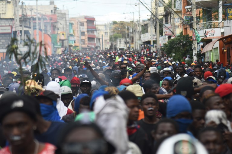 Facing cronyism and no work, young Haitians protest or flee