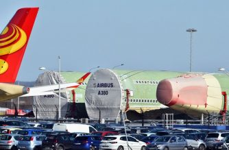 A picture taken on February 14, 2019 shows parts of the Airbus A380 MSN 266 at Aeroconstellation construction site in Blagnac, near Toulouse, southern France. - European aerospace giant Airbus said on February 14 it would end production of the A380 superjumbo, the double-decker jet which earned plaudits from passengers but failed to win over enough airlines to justify its massive costs. (Photo by REMY GABALDA / AFP)