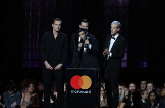 British band 'The 1975', Matthew Healy, Ross MacDonald, George Daniel and Adam Hann speak after collecting their British Album of the Year award during the BRIT Awards 2019 ceremony and live show in London on February 20, 2019. (Photo by Daniel LEAL-OLIVAS / AFP) / RESTRICTED TO EDITORIAL USE – NO POSTERS – NO MERCHANDISE– NO USE IN PUBLICATIONS DEVOTED TO ARTISTS