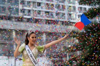 Miss Universe 2018 Catriona Gray of the Philippines waves to fans during a parade held in her honour in Manila on February 21, 2019, two months after she won the crown. (Photo by Noel CELIS / AFP)