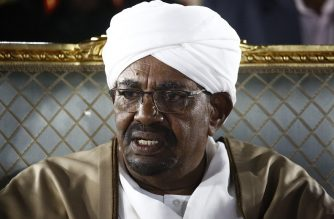 Sudanese President Omar al-Bashir sits before delivering a speech to the nation on February 22, 2019, at the presidential palace in the capital Khartoum. - Bashir declared a nationwide state of emergency on Febraury 22 and dissolved the government, in an effort to quell weeks of demonstrations that have rocked his iron-fisted rule of three decades. (Photo by ASHRAF SHAZLY / AFP)