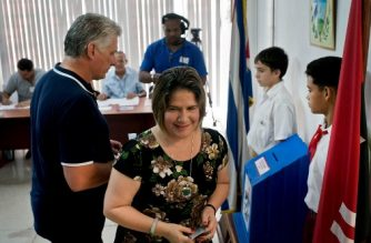 Cuban President Miguel Diaz-Canel and his wife Lis Cuesta vote in the referendum for the new Cuban Constitution in Havana, on February 24, 2019. - Cubans vote on a new constitution for the first time in decades, a poll seen as a possible referendum on the role of socialism itself in the one-party state. More than eight million Cubans are registered to vote on the first new charter since 1976. (Photo by Ramon Espinosa / POOL / AFP)