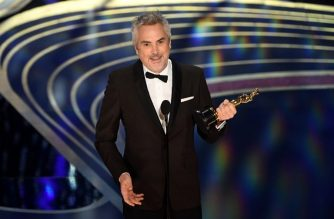 "Best Cinematography nominee for ""Roma"" Alfonso Cuaron accepts the award for Best Cinematography during the 91st Annual Academy Awards at the Dolby Theatre in Hollywood, California on February 24, 2019. (Photo by VALERIE MACON / AFP)"