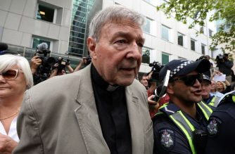 Cardinal George Pell leaves the County Court of Victoria court after prosecutors decided not to proceed with a second trial on alleged historical child sexual offences in Melbourne on February 26, 2019. - Australian Cardinal George Pell, who helped elect popes and ran the Vatican's finances, has been found guilty of sexually assaulting two choirboys, becoming the most senior Catholic cleric ever convicted of child sex crimes. (Photo by Asanka Brendon Ratnayake / AFP)