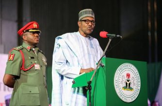 """Nigerian President Muhammadu Buhari (R) addresses the audience following his re-election, after Nigeria's Independent National Electoral Commission presented his certificate of election on February 27, 2019, in Abuja. - Muhammadu Buhari was on February 27 re-elected Nigeria's president after a delayed poll that angered voters and raised political temperatures, but the opposition immediately vowed to challenge the """"sham"""" result in court. (Photo by Kola SULAIMON / AFP)"""
