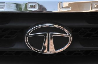 Tata Motors logo on the front of a Tata Sumo Gold during a launch ceremony in Hyderabad on February 15, 2012.   India's top vehicle maker Tata Motors has launched the vehicle in four variants on the Indian market from Indian Rupees 538,000 (USD 10,900).   AFP PHOTO/Noah SEELAM (Photo by NOAH SEELAM / AFP)