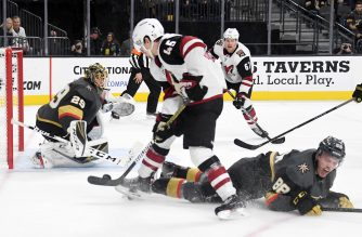 LAS VEGAS, NEVADA - FEBRUARY 12: Josh Archibald #45 of the Arizona Coyotes scores a third-period goal against Marc-Andre Fleury #29 and Nate Schmidt #88 of the Vegas Golden Knights during their game at T-Mobile Arena on February 12, 2019 in Las Vegas, Nevada. The Coyotes defeated the Golden Knights 5-2.   Ethan Miller/Getty Images/AFP