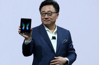 SAN FRANCISCO, CALIFORNIA - FEBRUARY 20: DJ Koh, President and CEO of IT & Mobile Communications Division of Samsung Electronics, holds the new Samsung Galaxy Fold smartphone during the Samsung Unpacked event on February 20, 2019 in San Francisco, California. Samsung announced a new foldable smartphone.   Justin Sullivan/Getty Images/AFP