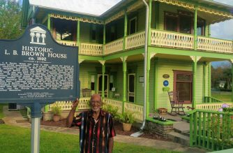 Clifton Lewis in front of the historic L. B. Brown House.  Photo by Melissa Sarmiento Allen, EBC Florida Bureau, Eagle News Service.
