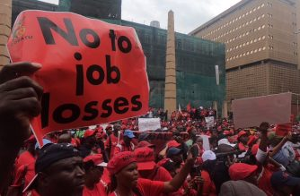 The Congress of South African trade unions (COSATU) holds a march in Johannesburg, as part of a national strike. Thousands of South African workers are staging nationwide demonstrations to protest against high unemployment and government economic policies that they say have failed to create jobs and are deepening poverty. (Photo grabbed from AFPTV/Courtesy Agence France Presse)