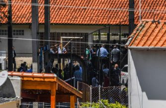 Police officers and authorities are seen at the scene of a shooting at the Raul Brasil public school in which ten people -including the two shooters- died and 15 resulted injured, in Suzano, Sao Paulo metropolitan region, Brazil, on March 13, 2019. - A shooting at a school near Sao Paulo on Wednesday left eight people dead, state military police said, before the two shooters turned their weapons on themselves. Far right President Jair Bolsonaro passed a law allowing people to carry arms soon after assuming power in January, delivering on a campaign promise. (Photo by NELSON ALMEIDA / AFP)