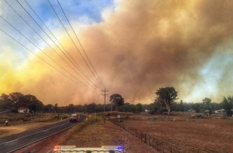 "This handout picture taken on February 13, 2019 and released by the Fire and Rescue New South Wales on February 15 shows smoke rising from a bushfire outside the town of Tingha in New South Wales. - Bushfires in the New South Wales northern towns of Tingha and Tabulam have destroyed more than 20 houses. (Photo by Handout / Fire and Rescue NSW / AFP) / ---EDITORS NOTE ----RESTRICTED TO EDITORIAL USE MANDATORY CREDIT "" AFP PHOTO / FIRE AND RESCUE NSW  / NO MARKETING NO ADVERTISING CAMPAIGNS - DISTRIBUTED AS A SERVICE TO CLIENTS"