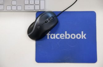 "(FILES) In this file photo taken on December 04, 2017 A mousepad with the Facebook logo is seen at Facebook's new headquarters, designed by Canadian-born American architect Frank Gehry, at Rathbone Place in central London. - A scathing British parliamentary report on February 18, 2019, branded Facebook ""digital gangsters"" that knowingly violated data privacy and competition laws. Lawmakers' 18-month investigation into disinformation and ""fake news"" also accused Facebook of failing to faithfully fight Russia's alleged attempts to influence elections. (Photo by Daniel LEAL-OLIVAS / AFP)"