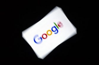 This illustration picture shows the US  multinational technology and Internet-related services company Google logo displayed on a tablet in Paris on February 18, 2019. (Photo by Lionel BONAVENTURE / AFP)
