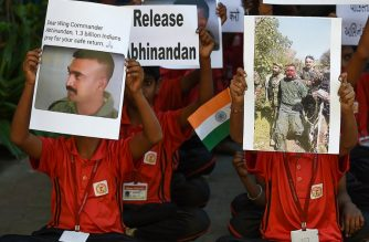 "Indian students pray for a speedy release of Indian Air Force pilot Abhinandan Varthaman, in a school in Ahmedabad on February 28, 2019. - Pakistan said on February 28 it will release a captured Indian pilot in a ""peace gesture"", taking a step towards rapprochement as clashes between the nuclear-armed rivals ignited fears of a disastrous conflict. (Photo by SAM PANTHAKY / AFP)"