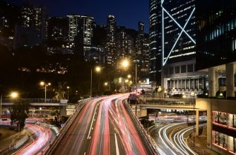 This long exposure photo shows the trails of vehicle lights on main roads in Hong Kong on February 28, 2019. (Photo by Anthony WALLACE / AFP)
